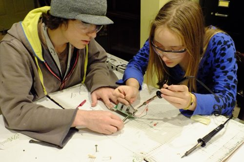 Derrick and Haley replace a resistor in the bidirectional motor controller .